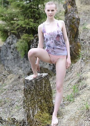 Hot blonde teen gives a stunning erotic strip and tease show before posing in nature with her naked slender body.